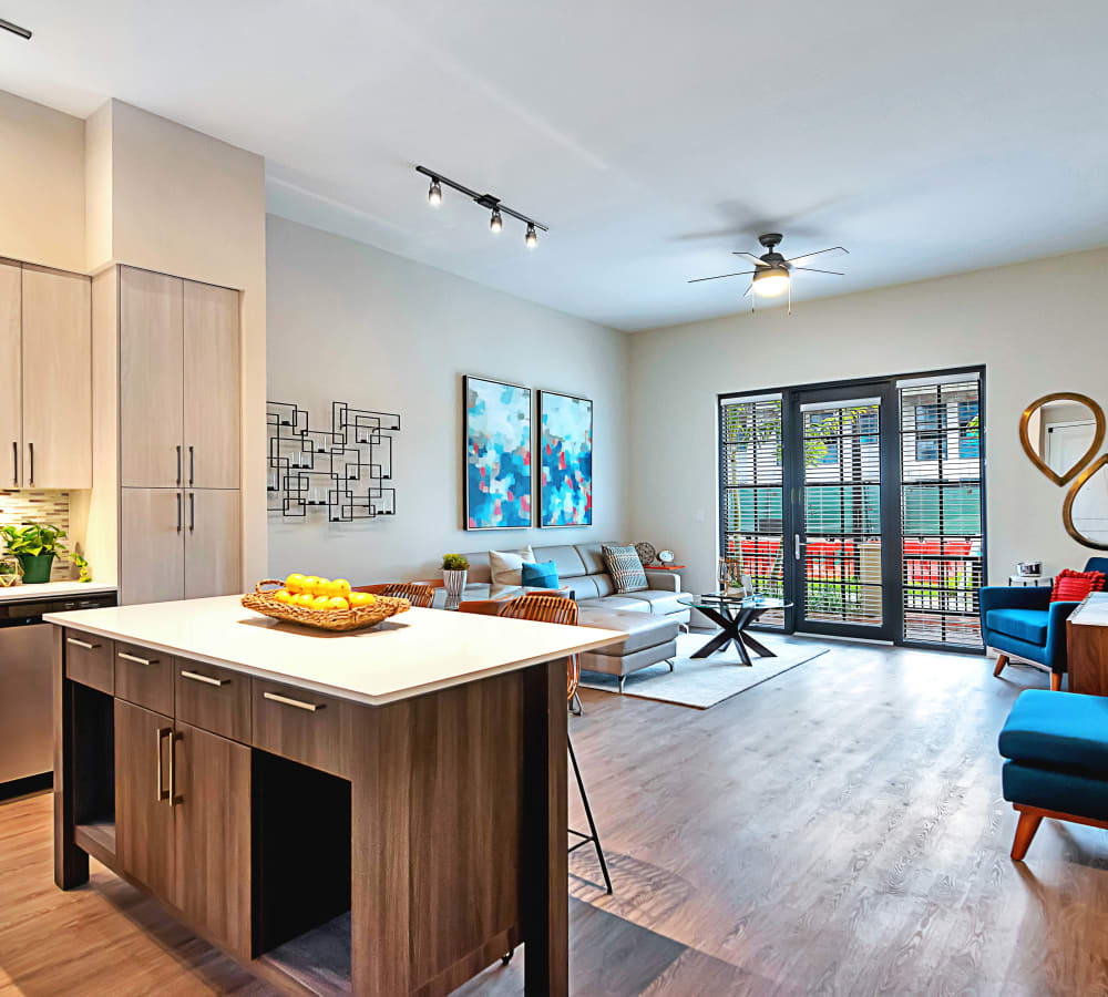 Large sliding doors in living room to let tons of natural light in at 6600 Main in Miami Lakes, Florida