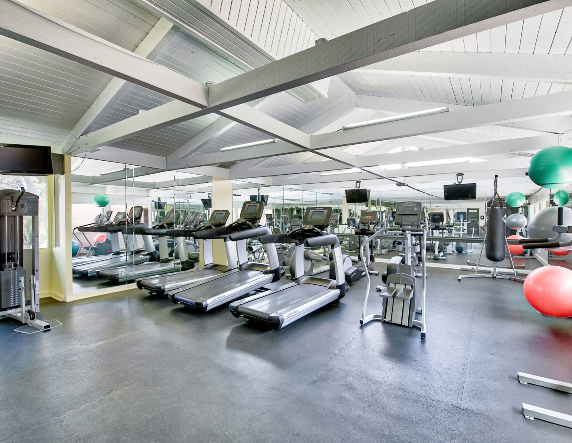 Very well-equipped fitness center at Mediterranean Village Apartments in Costa Mesa, California