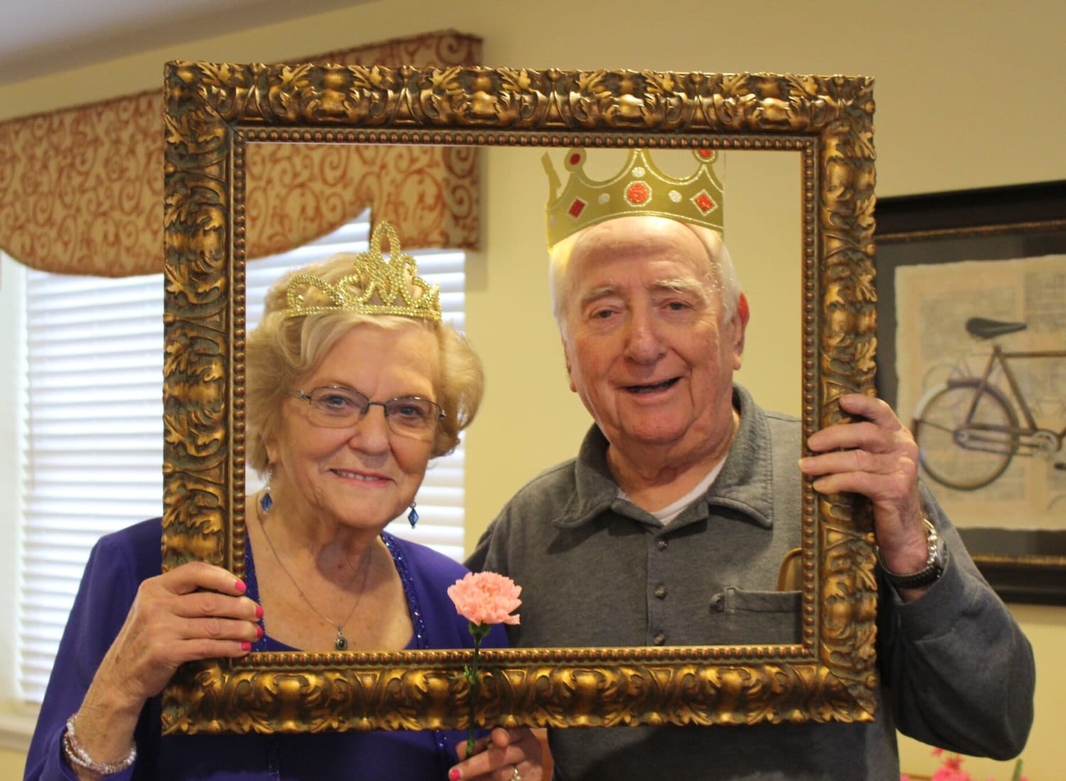 Resident couple posing in a photo frame at The Birches at Newtown in Newtown, Pennsylvania
