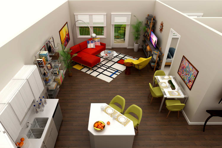 Open-concept floor plan with wood-style flooring at Town Court in West Bloomfield, Michigan