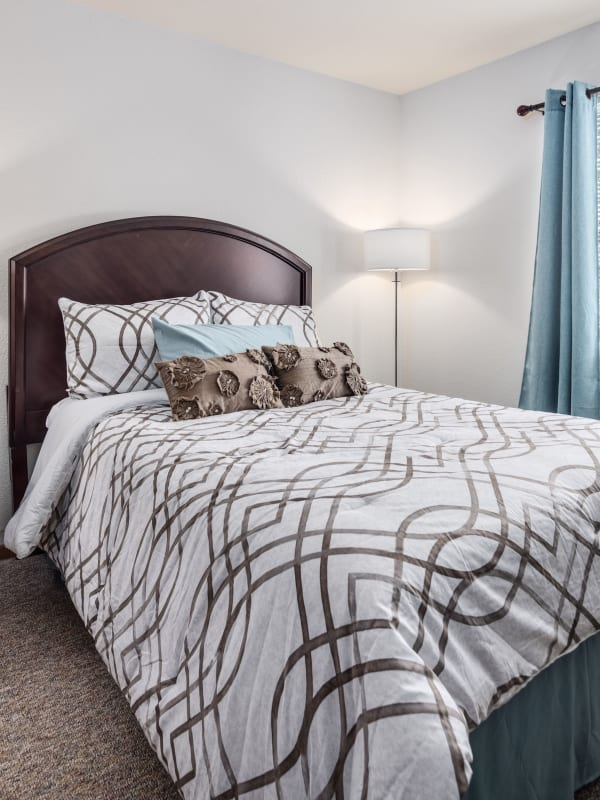 A freshly made bed at Parkside of Livonia in Livonia, Michigan