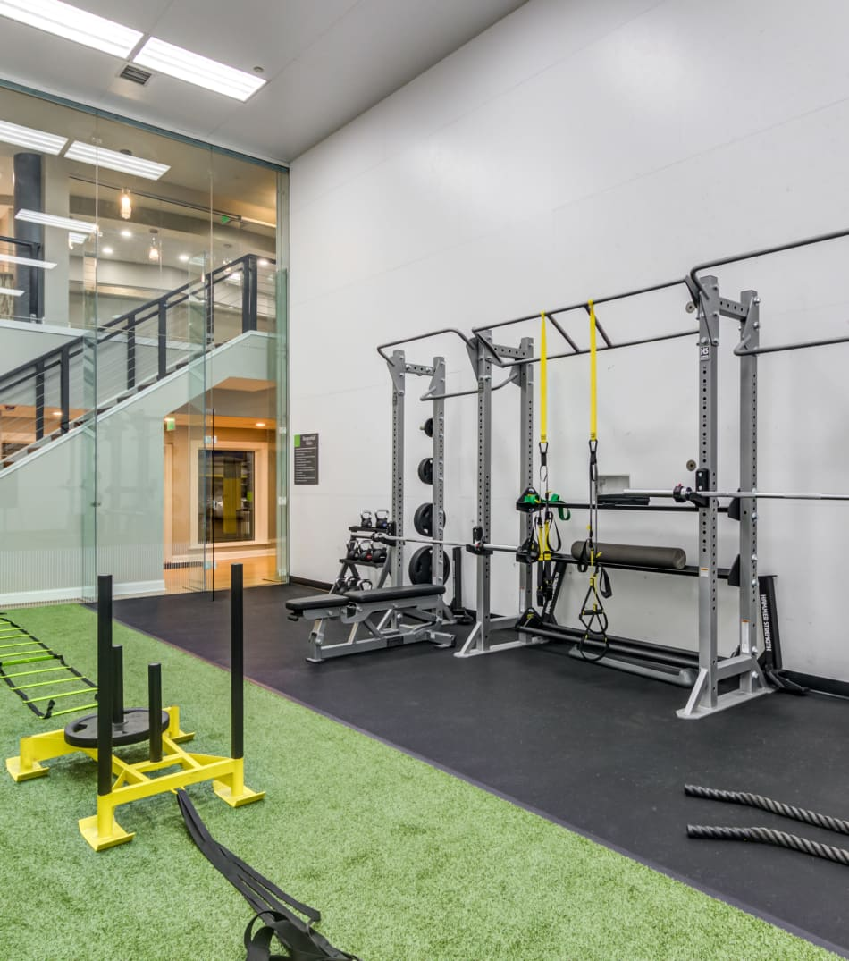 Weight racks and a sled in the fitness center at Sofi Parc Grove in Stamford, Connecticut