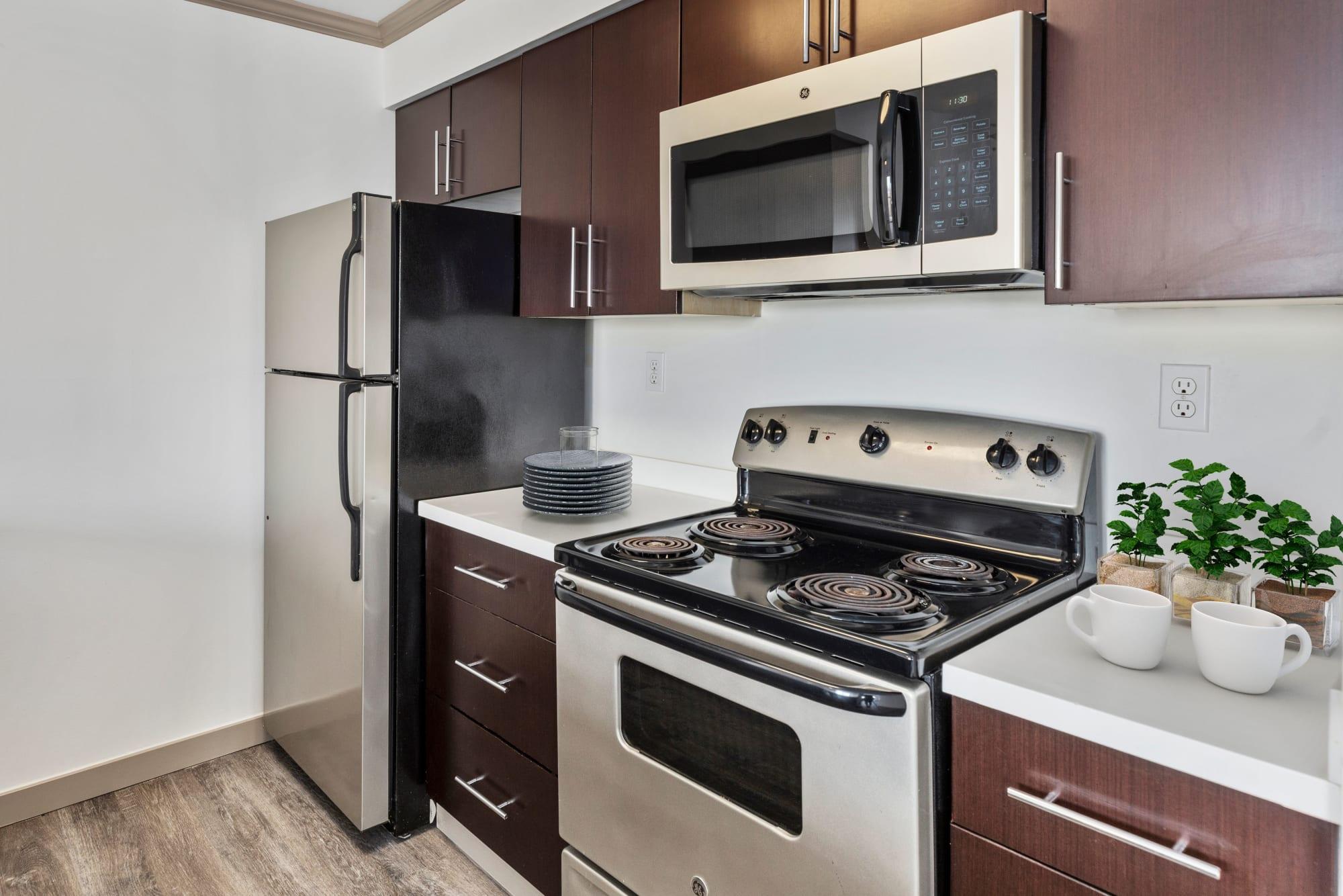 A kitchen with modern stainless appliances at Elan 41 Apartments in Seattle, Washington