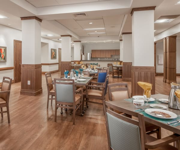 Bright dining area for residents at All Seasons Naples in Naples, Florida