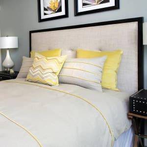 Luxury master bedroom in model home at Harrison Tower in Portland, Oregon