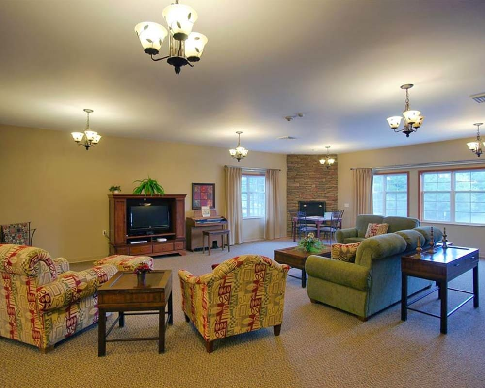 Comfortable resident lounge with TV at Milestone Senior Living in Rhinelander, Wisconsin.