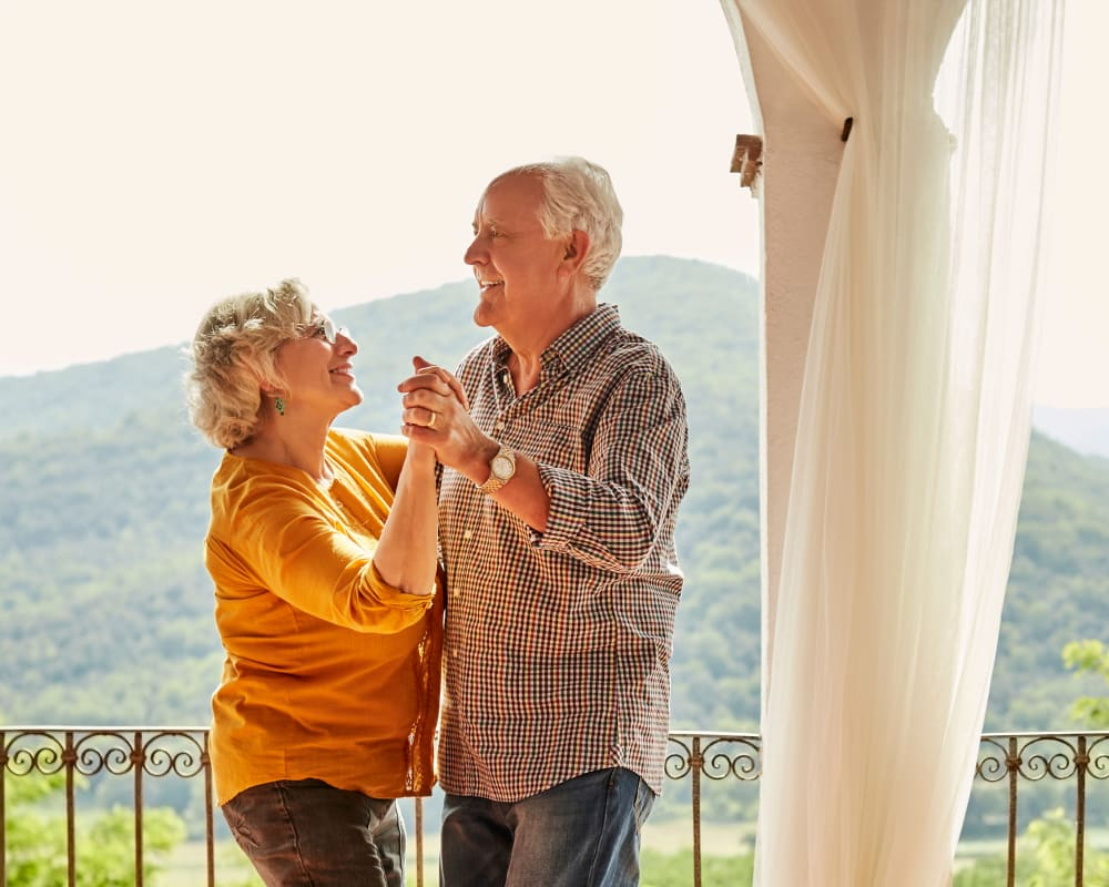 Couple dancing on the balcony at Pasadena Highlands in Pasadena, California