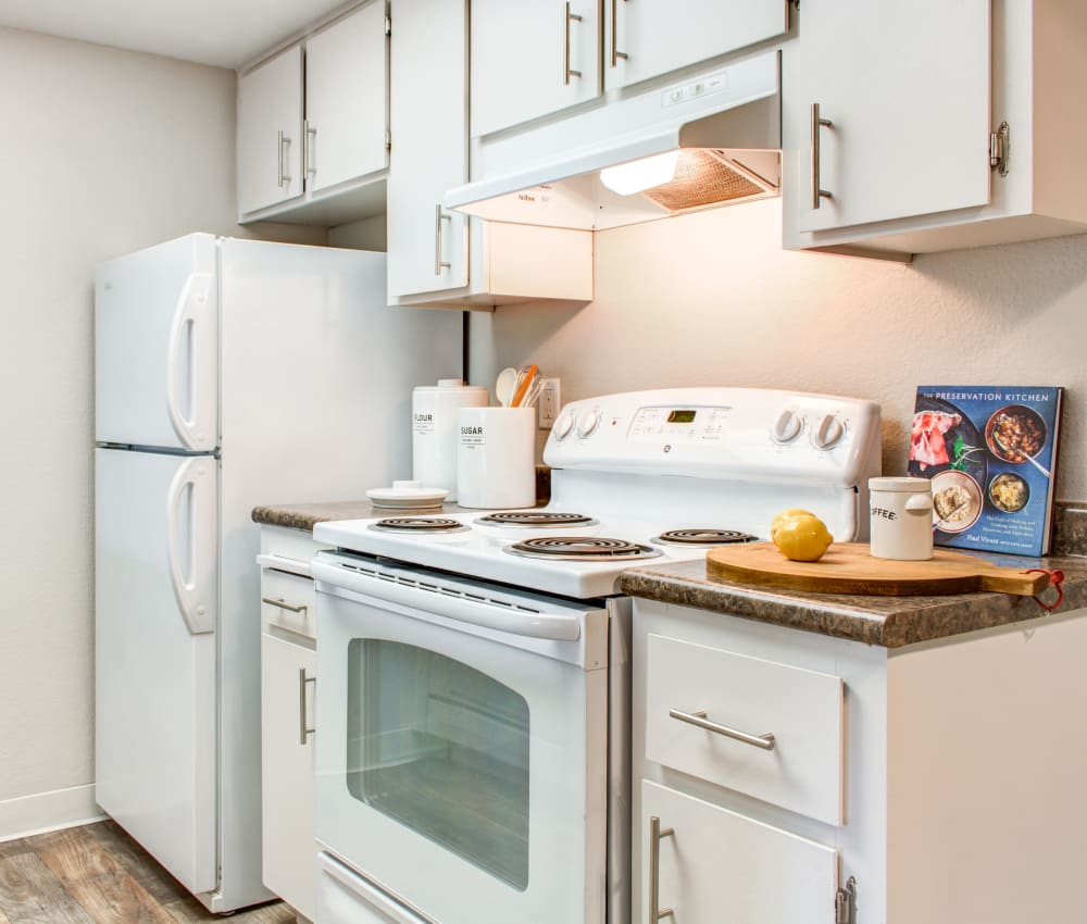 Modern kitchen with bright white appliances and ample cupboard space in a model home at Sofi Dublin in Dublin, California