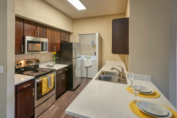 Kitchen and Dining Room at The Crossings at Bear Creek Apartments in Lakewood