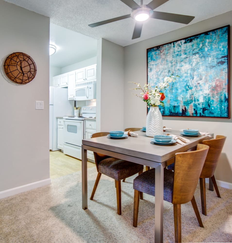 Dining area next to the modern kitchen in a model home at Waterstone Fremont in Fremont, California
