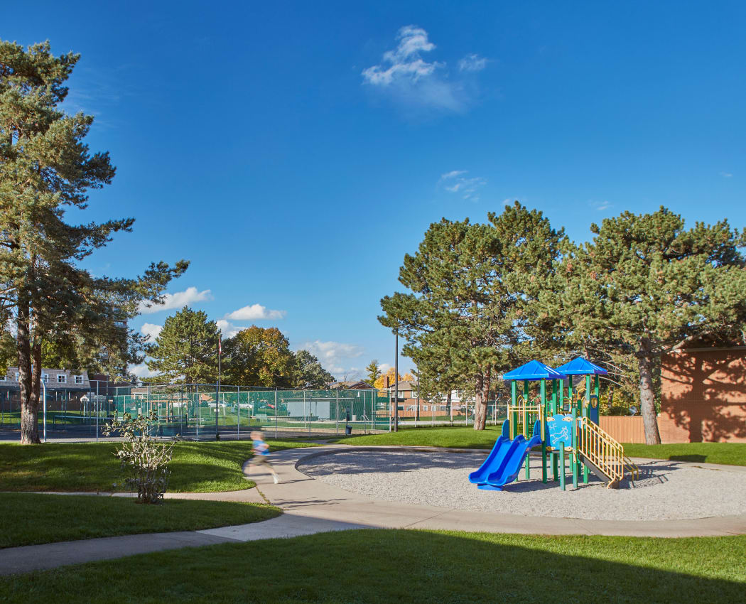 Kid running near the playground at Georgian Court Estates in Burlington, Ontario