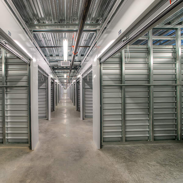 Open indoor storage units with bright lighting at StorQuest Self Storage in Phoenix, Arizona