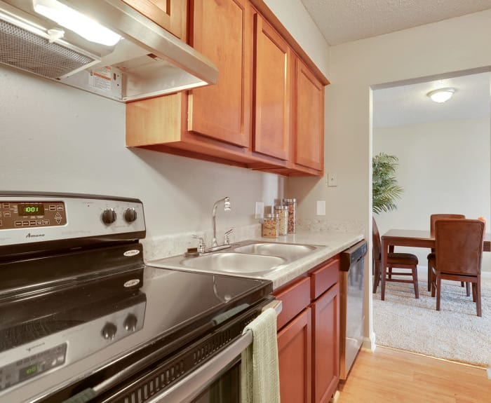 Kitchen is open to the dining room at Avalon Apartment Homes in Baton Rouge