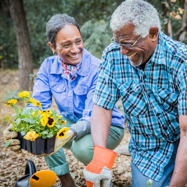 Residents planting flowers at The Atrium at Carmichael in Carmichael, California