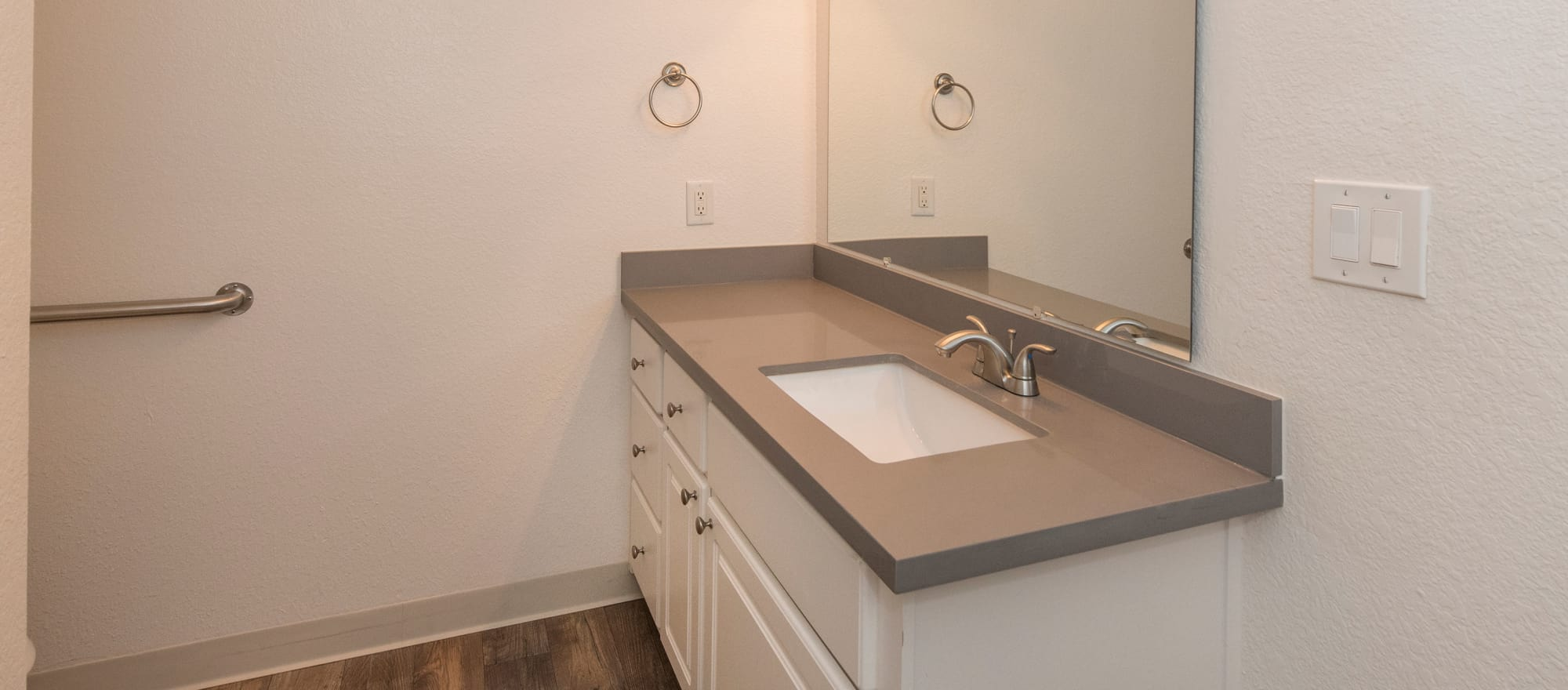 Model bathroom with white cabinetry at Sterling Heights Apartment Homes in Benicia, California