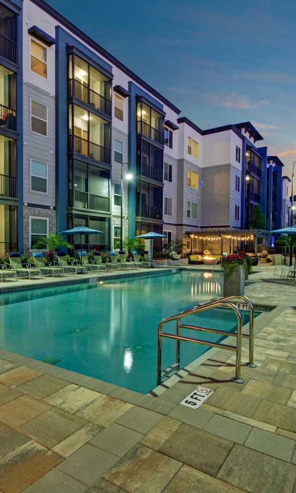 Gorgeous swimming pool and lounge area at The Courtney at Lake Shadow in Orlando, Florida