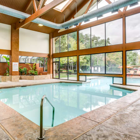 Refreshing interior/exterior swimming pool at Springs of Country Woods Apartments in Midvale