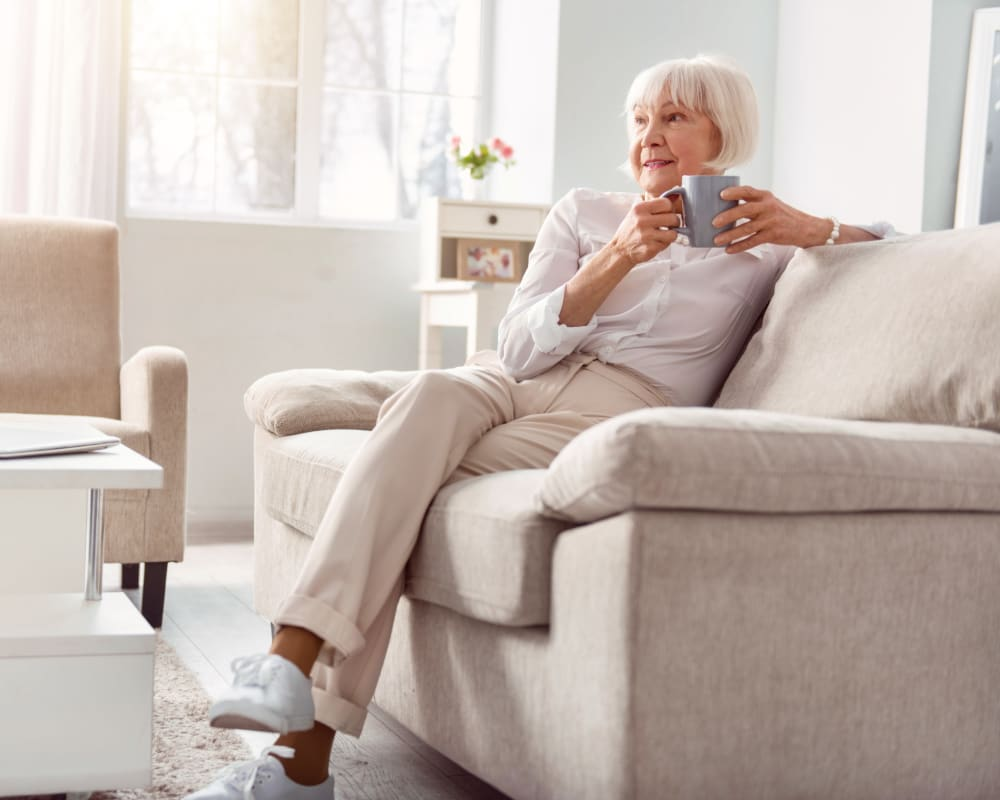 Resident relaxing in her spacious living room at WellQuest of Granite Bay in Granite Bay, California