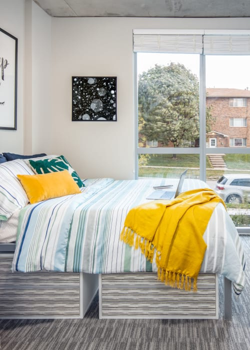Bedroom with space for a study area at RISE at Riverfront Crossings in Iowa City, Iowa