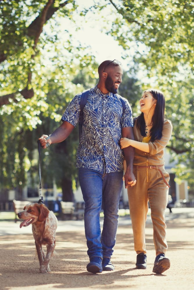 Residents walking their dog at 300 Optimist Park in Charlotte, North Carolina