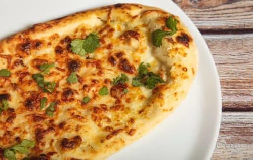 Cheese Naan W/Garlic - Sargun Indian Tandoori