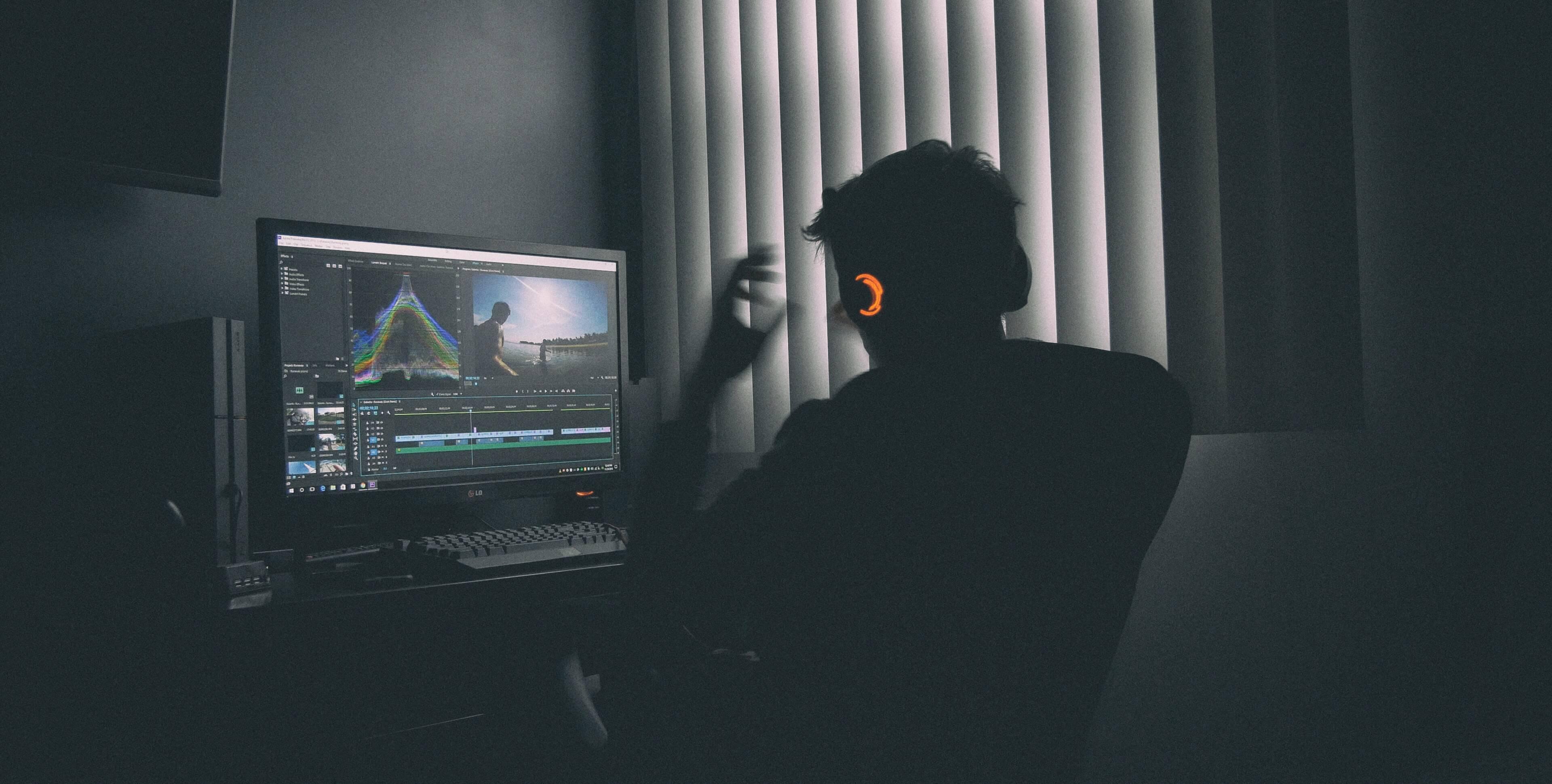 Gamer in darkened room