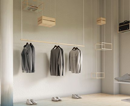 IED - long-sleeved shirts on display in an industrially designed room