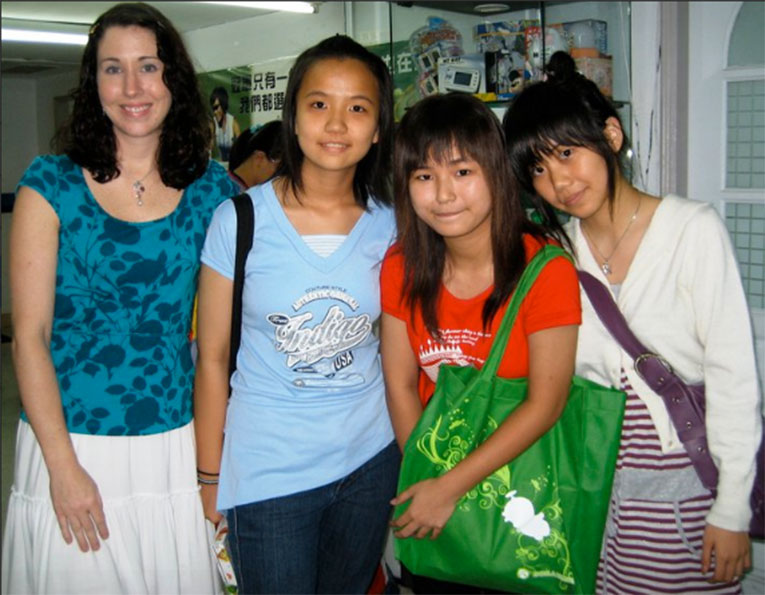 International teachers with students in Asia