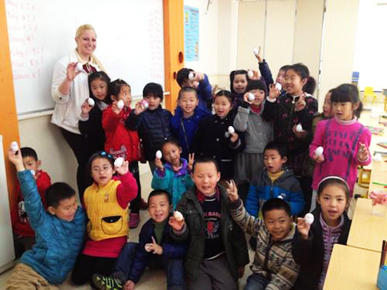 International teacher with students in Shanghai, China