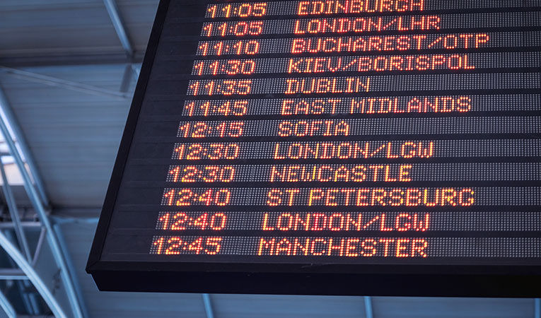 departures board with international cities