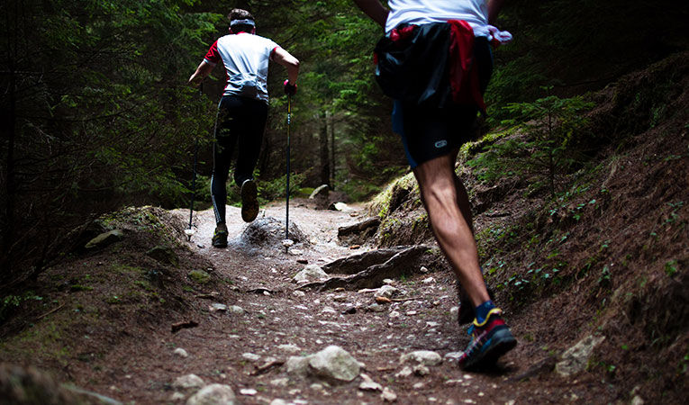 Two men running trails in Romania while studying abroad