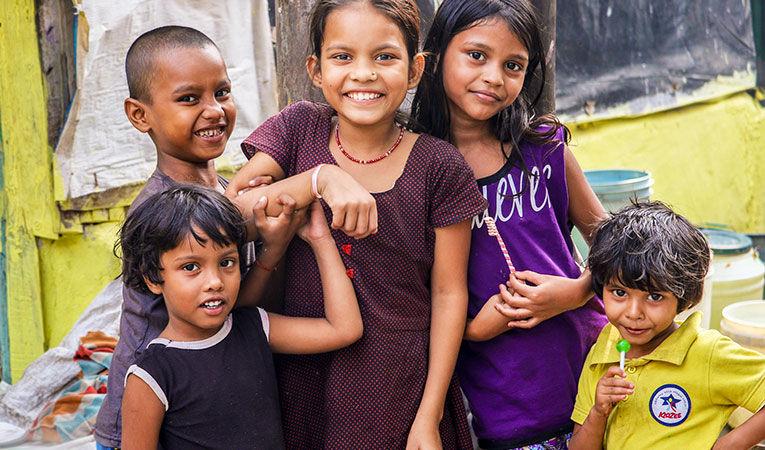 smiling children posing for photo