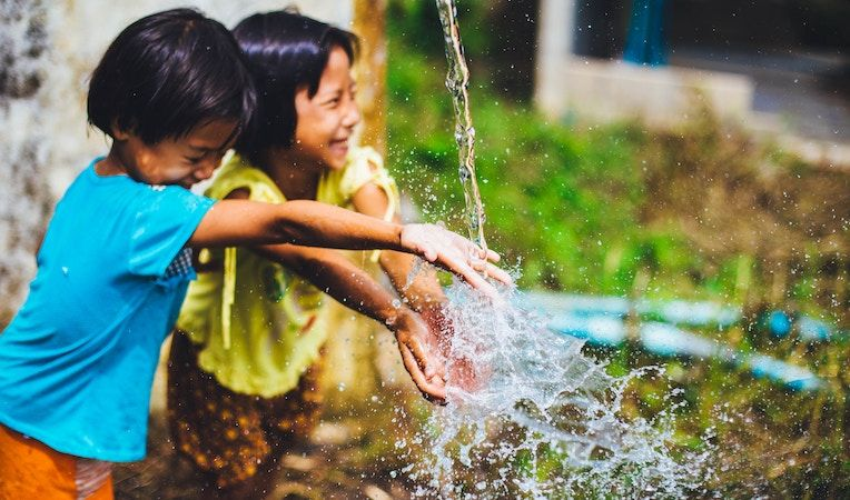 girls playing with water