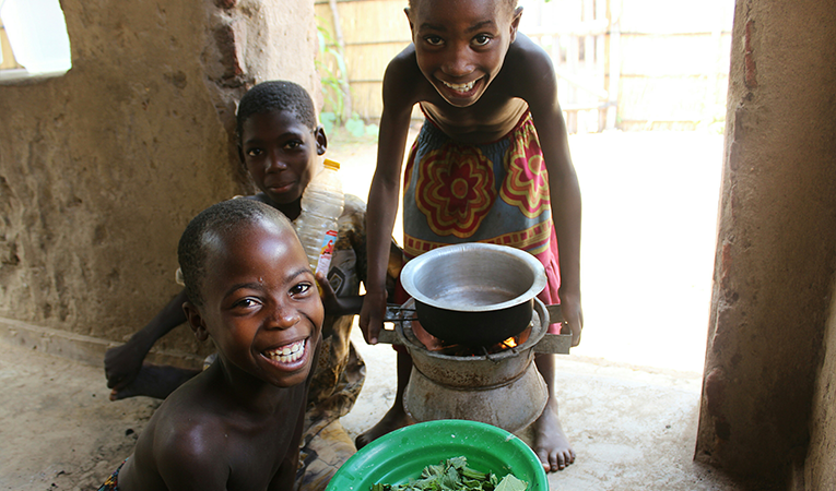 Three smiling African children with supper