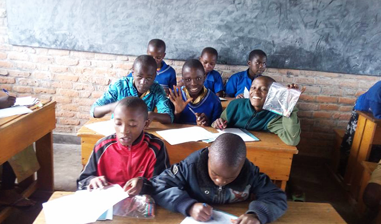 Young African boys sitting in the back of the classroom