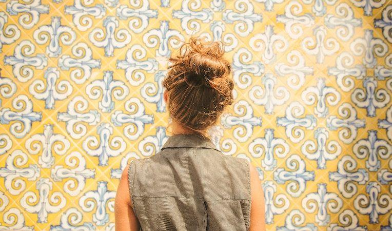 woman looking at an inspirational wall