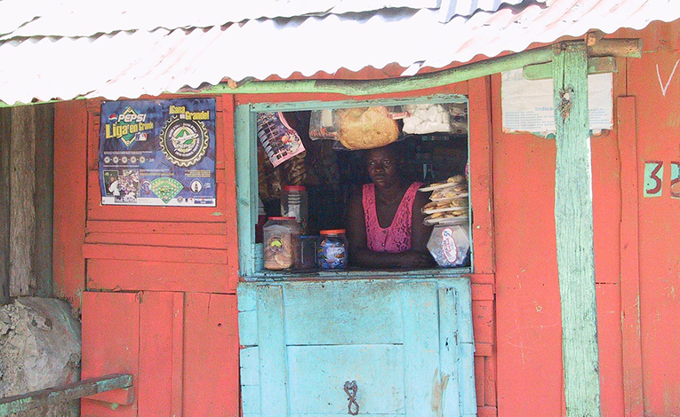 Local woman in her storefront in Haiti