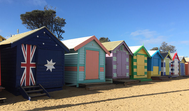 Eighty-two century-old bathing boxes line the shore of Brighton Beach just outside Melbourne, Australia.