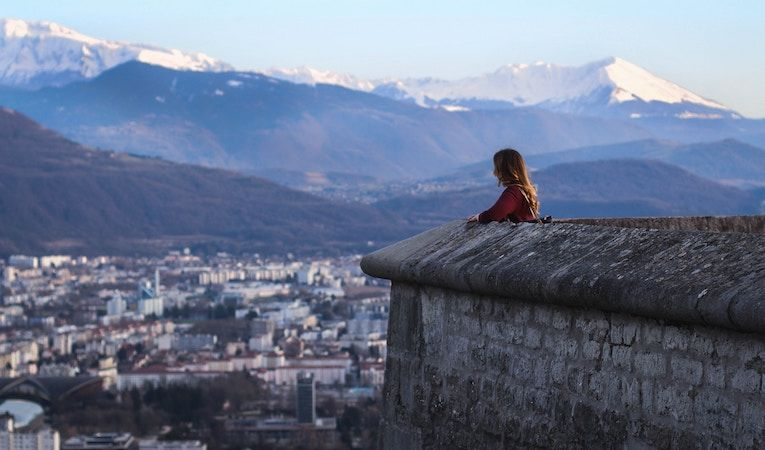 student looking out at Grenoble, France and the mountains