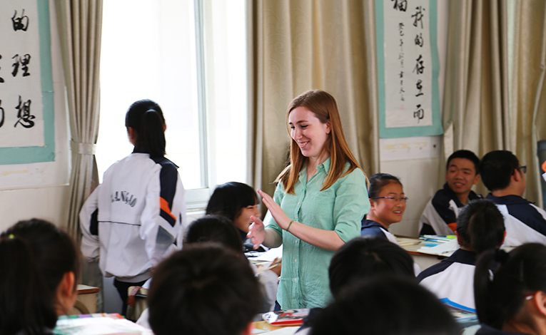 Foreign teacher playing a game with Chinese students
