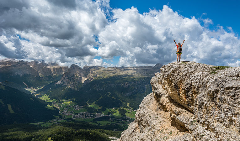 standing on top a mountain in Italy
