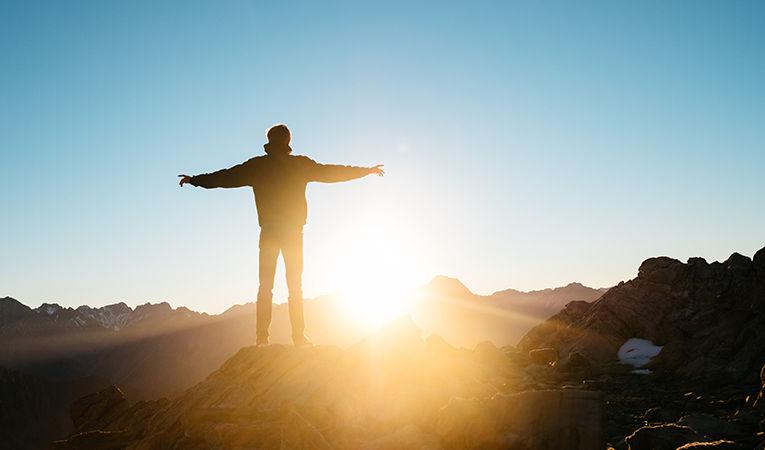 Mt. Cook, New Zealand, standing in the sunlight