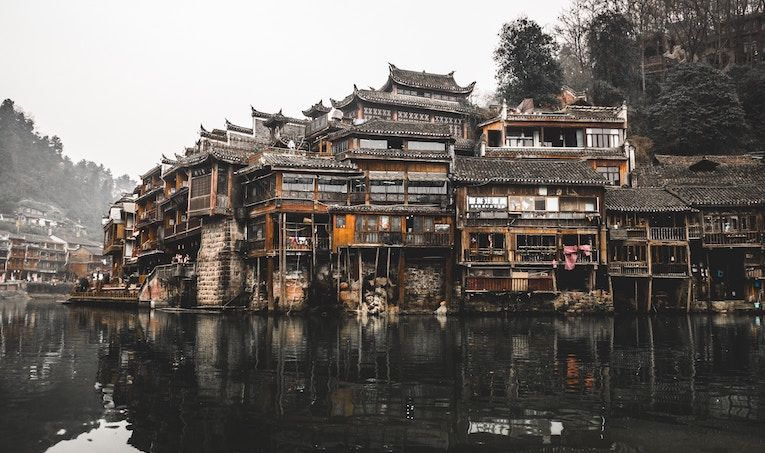 traditional chinese homes along a river