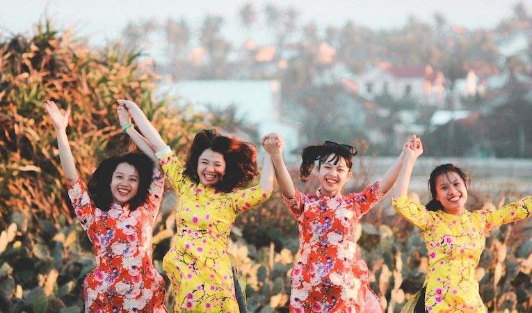 girls swinging arms in vietnam