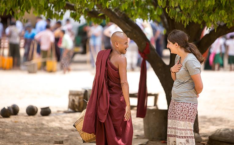 Volunteer talking to a local in Myanmar
