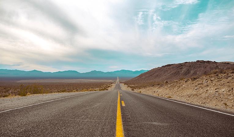 straight desert highway facing horizon