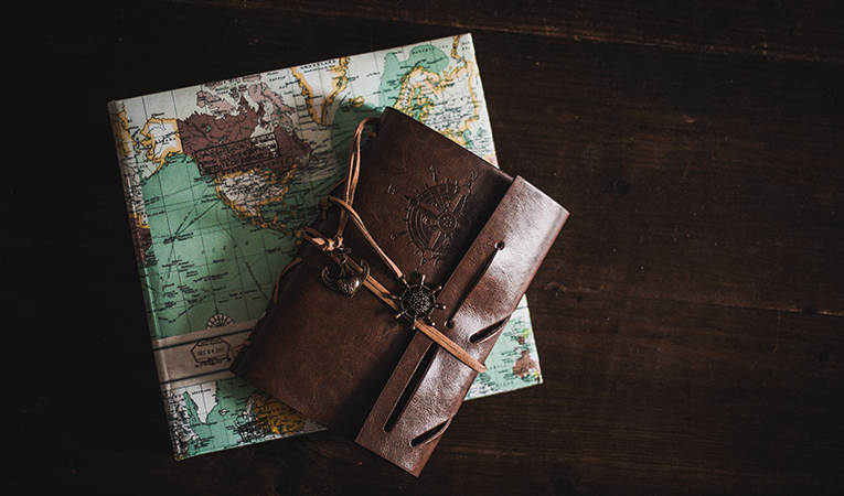 Travel journals on table