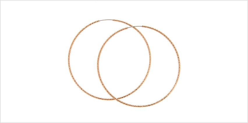 Go to Product: Rose Gold 60MM Textured Hoop Earrings from Claires