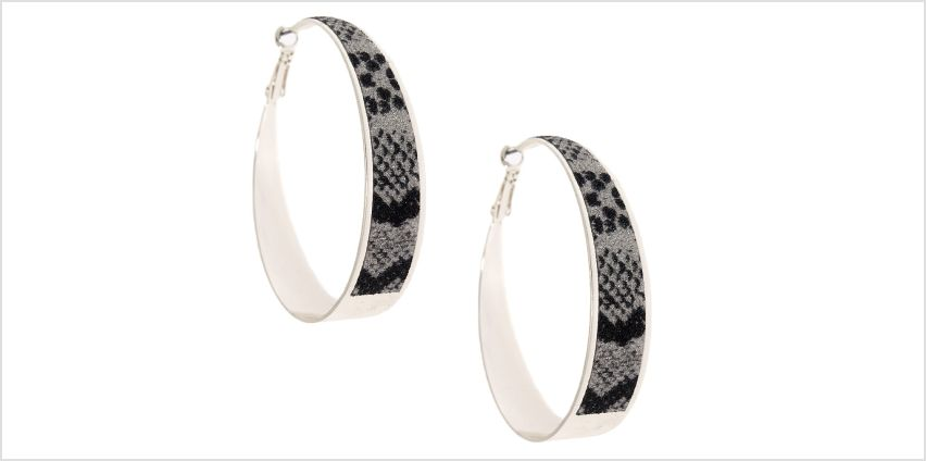 Go to Product: Silver 60MM Glitter Snake Print Hoop Earrings from Claires