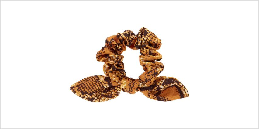 Go to Product: Snakeskin Knotted Bow Hair Scrunchie - Yellow from Claires